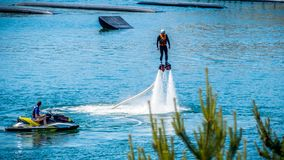 Flyboard. Air flight by hoverboard. stock photography