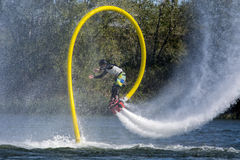Flyboard flip. A man on a flyboard is doing a perfect spctacular somersault (flip) on the st-Lawrwrence river in verdun quebec photo taken on 24th of september stock photos