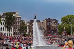 A flyboard guy in Amsterdam. A flyboard guy on the Amstel. Gay Pride Canal Parade 2015 in Amsterdam the Netherlands stock photo
