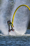 Fly board over the water. A man on a fly board is rising over the water of the st-lawrwrence river, push by the jet of the flyboard in verdun quebec, photo taken stock photo