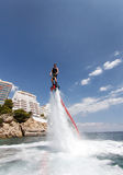 Flyboard practice. A young man practices flyboard, a new aquatic sport where a board is powered by water jet system, in the island of Mallorca, Spain stock photo