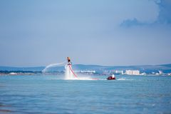 Flyboard sea. The new spectacular extreme sport called  flyboard Stock Photo