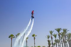 Flyboard Show At The Pool Of TT Pegasos World Hotel In Turkey. Royalty Free Stock Photos