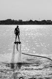 Flyboard and ski jet performing stunts Stock Image