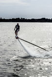 Flyboard and ski jet performing stunts Stock Photo