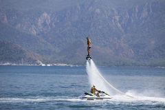 Flyboard. Unidentified man on flyboard at Marmaris, Turkey. Flyboard was invented in spring 2011 by a French watercraft rider, Franky Zapata Stock Photography