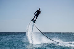 Flyboarding in the Caribbean. Flyboarding at Curacao, Dutch Antilles, Island in the Caribbean Royalty Free Stock Images