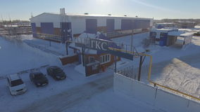 Flycam moves above oil company entrance with control post stock video