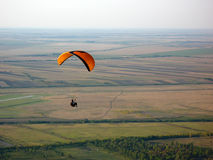 Flyer. Paraglider flying over the fields Royalty Free Stock Image
