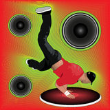 Flyer bboy in cap shows power moves. Young break dancer in blank rap cap shows power moves during battle or party on abstract background with loudspeakers and Royalty Free Stock Photo