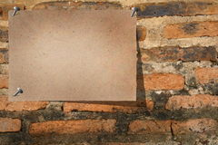 Flyer at Brick Wall Stock Image