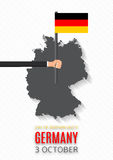 Flyer with Germany map and hand hold flag Royalty Free Stock Images