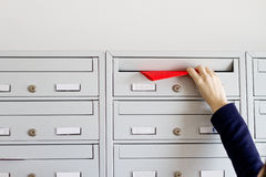 Flyer in mailbox. Humand hand inserting advertising flyer in mailbox Stock Image