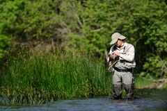 Flyfisher angling on the river Stock Photos