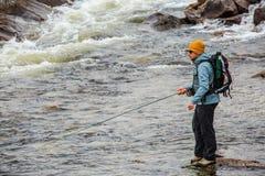 Flyfisherman в глуши Стоковое Фото