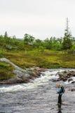 Flyfisherman in wilderness Stock Image
