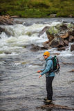Flyfisherman in wilderness Royalty Free Stock Images