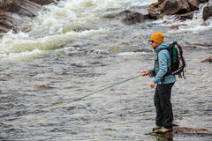 Flyfisherman in wilderness Stock Photo