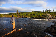 Flyfisherman in wilderness Royalty Free Stock Photography