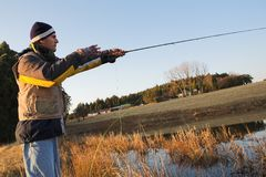 Flyfishing #17. A fly fisherman casting a line in Dullstroom, South Africa Stock Photography