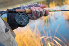 Flyfishing #20. A fly fishermans spinner - Focus on spinner and line, Shallow DOF Royalty Free Stock Image