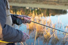 Flyfishing #21. A fly fishermans spinner - Focus on spinner and line, Shallower DOF Stock Image