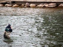 FlyFishing in Colorado. Man enjoying his time flyfishing in Colorado Stock Photo