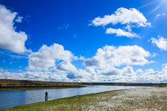 Flyfishing in Patagonia. Flyfishenrman in the river fishing for seatrout, Rio Gallegos, Argentina Stock Photo