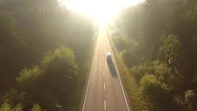 Flyg över vägen på soluppgång stock video