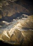 flyg- bergsolnedgång Arkivfoto