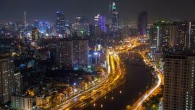Flyg- cityscape för Ho Chi Minh stadsnatt, Vietnam timelapse lager videofilmer
