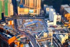 Flyg- cityscapesikt med byggnadskonstruktion Hong Kong til Fotografering för Bildbyråer