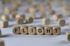 Flyg - kub med bokstäver, tecken med träkuber Royaltyfri Fotografi