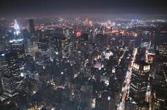 Flyg- nattsikt av Newet York City Fotografering för Bildbyråer
