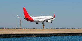Flyg och aktiviteter för kommersiellt flygplan på den Sydney flygplatsen Aus Arkivfoto