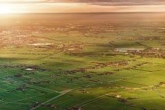 Flyg- sikt av Amsterdam Netherland Flyg- solnedgångsikt Fotografering för Bildbyråer