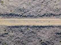 Flyg- sikt av en grusväg Bildat av korsningen av av-väg medel Arkivfoto