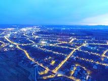 Flyg- sikt av en stad i natt Royaltyfria Bilder