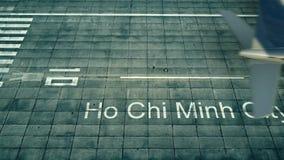 Flyg- sikt av ett flygplan som ankommer till den Ho Chi Minh City flygplatsen Lopp till den Vietnam 3D tolkningen Arkivbild