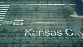 Flyg- sikt av ett flygplan som ankommer till den Kansas City flygplatsen Lopp till tolkningen för Förenta staterna 3D Arkivfoto