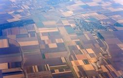 Flyg- sikt av fält i lantbruk fotografering för bildbyråer