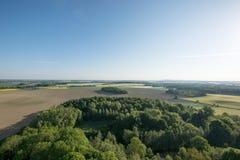 Flyg- sikt av fält i morgonen Royaltyfria Bilder