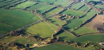 Flyg- sikt av gräsplanfält och lutningar Royaltyfri Fotografi