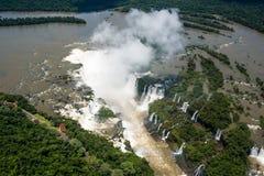 Flyg- sikt av Iguazu Falls i solsken Royaltyfria Foton