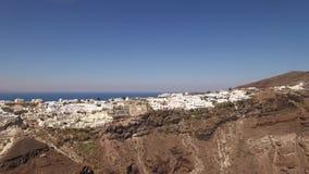 Flyg- sikt av Oia, Santorini, Grekland lager videofilmer