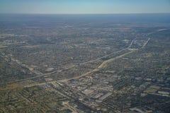 Flyg- sikt av Santa Fe Springs, Norwalkm blåklocka, Downey, VI Royaltyfri Fotografi
