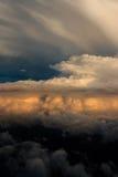 Flyg- sikt av stormmoln på solnedgången Fotografering för Bildbyråer