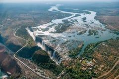 Flyg- sikt av Victoria Falls på Zambezi River Royaltyfri Foto