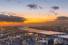 Flyg- sikt för Osaka stad med solnedgånghimmel Royaltyfria Foton