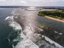 Flyg- sikt för Serangan strand Arkivbilder